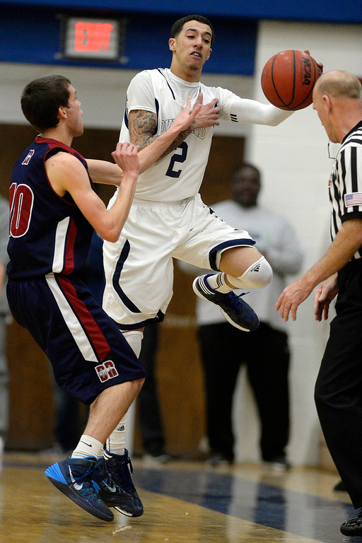 . T�Aren Williams (2) of the Overland Trailblazers steals the ball from Cody Pittman (10) of the Dakota Ridge Eagles during the first half. (Photo By AAron Ontiveroz/The Denver Post)
