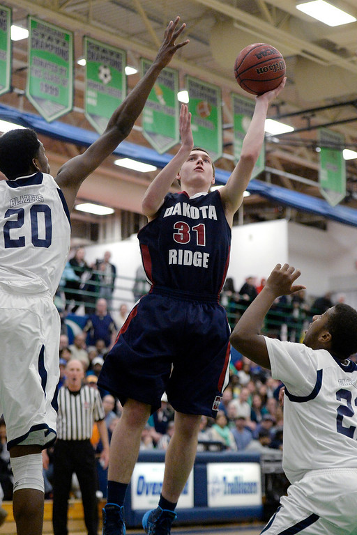 . Mason Grothuesmann (31) of the Dakota Ridge Eagles puts a shot up over De�Ron Davis (20) of the Overland Trailblazers during the second half of Overland\'s 67-59 win. (Photo By AAron Ontiveroz/The Denver Post)