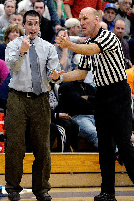 . Head coach Curi Yutzy of the Dakota Ridge Eagles argues a call with a referee during the second half of Overland\'s 67-59 win. (Photo By AAron Ontiveroz/The Denver Post)