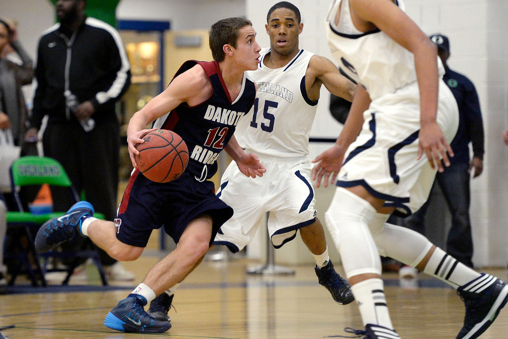 . Jake Flores (12) of the Dakota Ridge Eagles drives on Austin Conway (15) of the Overland Trailblazers during the first half. (Photo By AAron Ontiveroz/The Denver Post)