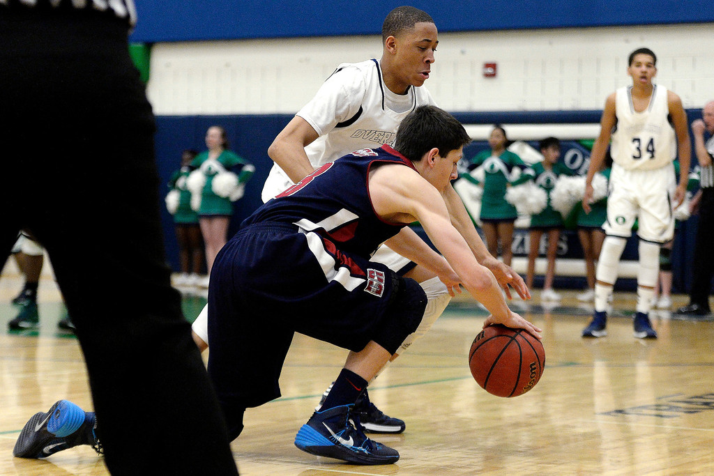. Jaervae Robinson (1) of the Overland Trailblazers plays tight defense on Cambrian Antrillo (3) of the Dakota Ridge Eagles during the first half. (Photo By AAron Ontiveroz/The Denver Post)