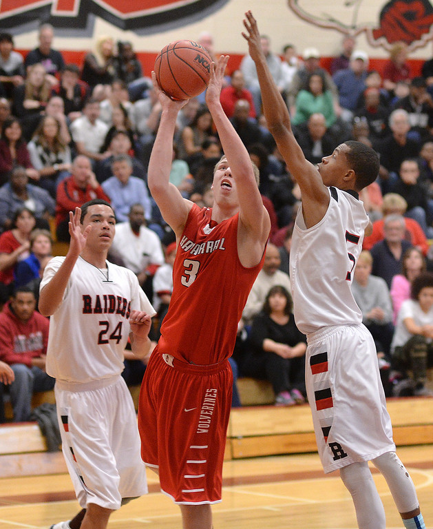 . AURORA, CO. - MARCH 5, 2014: Chaparral junior forward Chris Moody (3) worked between Raiders\' defenders Tarren Storey-Way (24) and Tyrei Randall (5). The Rangeview High School boy\'s basketball team defeated Chaparral 88-85 in the second overtime period Wednesday night, March 5, 2014. Photo By Karl Gehring/The Denver Post
