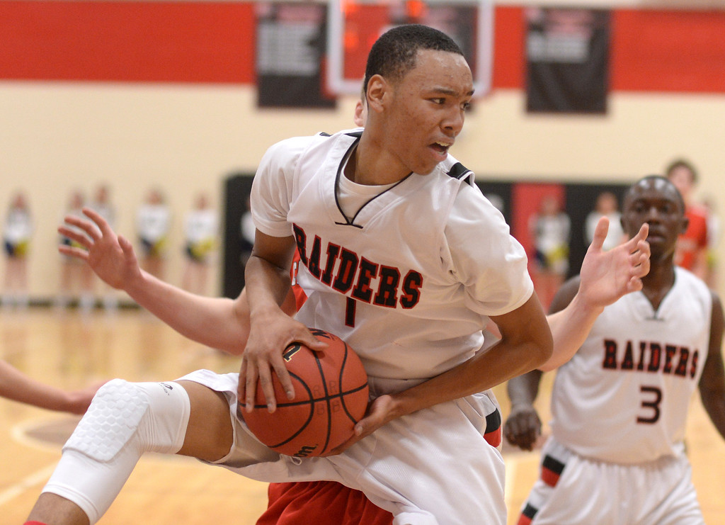 . AURORA, CO. - MARCH 5, 2014: Rangeview junior forward Jalen Davis (1) secured a reboud in the first half. The Rangeview High School boy\'s basketball team hosted Chaparral Wednesday night, March 5, 2014. Photo By Karl Gehring/The Denver Post
