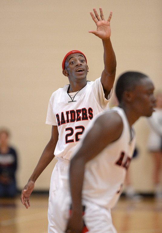 . AURORA, CO. - MARCH 5, 2014: Raiders senior Jeremiah Paige got the attention of his teammates late in the fourth quarter. The Rangeview High School boy\'s basketball team defeated Chaparral 88-85 in the second overtime period Wednesday night, March 5, 2014. Photo By Karl Gehring/The Denver Post