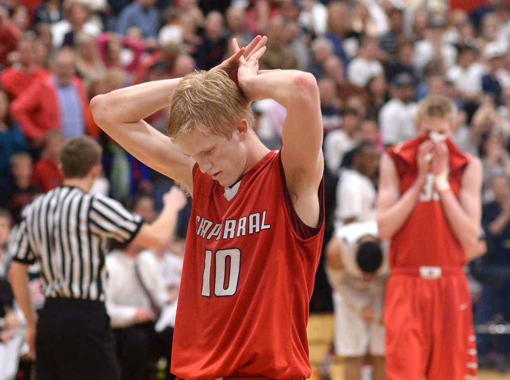 . AURORA, CO. - MARCH 5, 2014: Chaparral\'s Jake Holtzmann (10) and Hayden Dalton (33) reacted as the Raiders got a call late in the second overtime period. The Rangeview High School boy\'s basketball team defeated Chaparral 88-85 in the second overtime period Wednesday night, March 5, 2014. Photo By Karl Gehring/The Denver Post