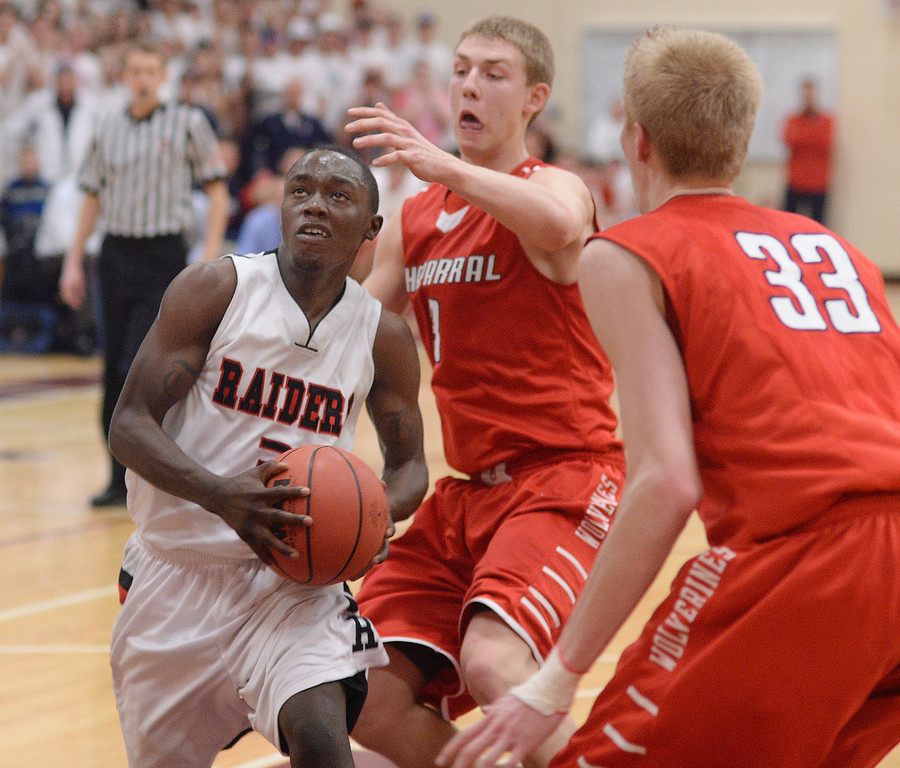 . AURORA, CO. - MARCH 5, 2014: Raiders senior guard Trey Bridges (3) muscled his way through traffic in the first overtime period. The Rangeview High School boy\'s basketball team defeated Chaparral 88-85 in the second overtime period Wednesday night, March 5, 2014. Photo By Karl Gehring/The Denver Post
