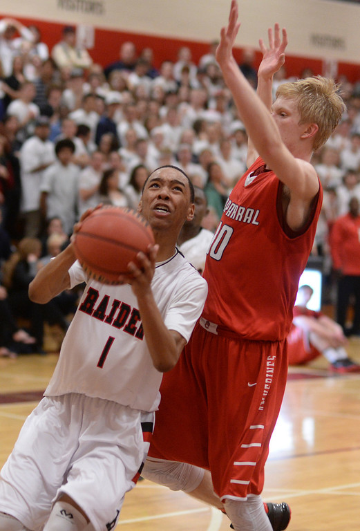 . AURORA, CO. - MARCH 5, 2014: Raiders\' forward Jalen Davis (1) drove past Chaparral defender Jake Holtzmann (10) late in the fourth quarter. The Rangeview High School boy\'s basketball team defeated Chaparral 88-85 in the second overtime period Wednesday night, March 5, 2014. Photo By Karl Gehring/The Denver Post
