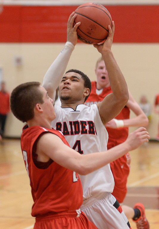 . AURORA, CO. - MARCH 5, 2014: Raiders\' guard Tim Wyatt (4) drove the lane against Chaparral defender Chase Coon (23) in the first overtime period. The Rangeview High School boy\'s basketball team defeated Chaparral 88-85 in the second overtime period Wednesday night, March 5, 2014. Photo By Karl Gehring/The Denver Post
