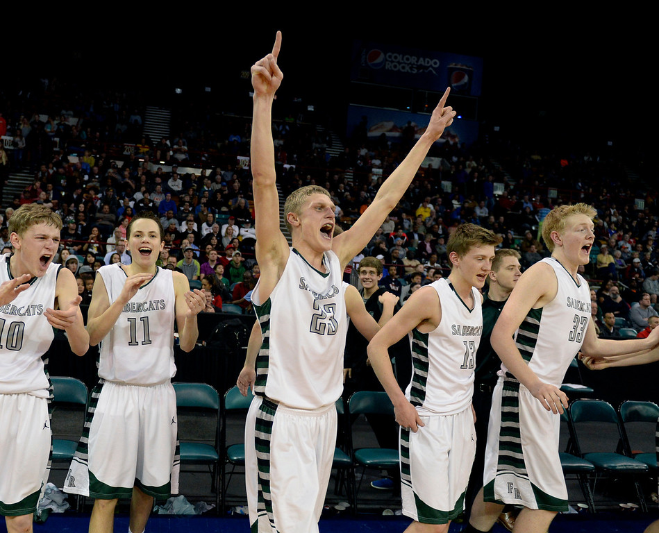 . DENVER, CO - MARCH 7: Fossil Ridge senior Alex Semadeni (23) celebrated at the final buzzer. The Fossil Ridge High School boy\'s basketball team defeated Arapahoe 68-58 in a 5A quarterfinal playoff game Friday night, March 7, 2014 in Denver, Colorado. (Photo by Karl Gehring/The Denver Post)