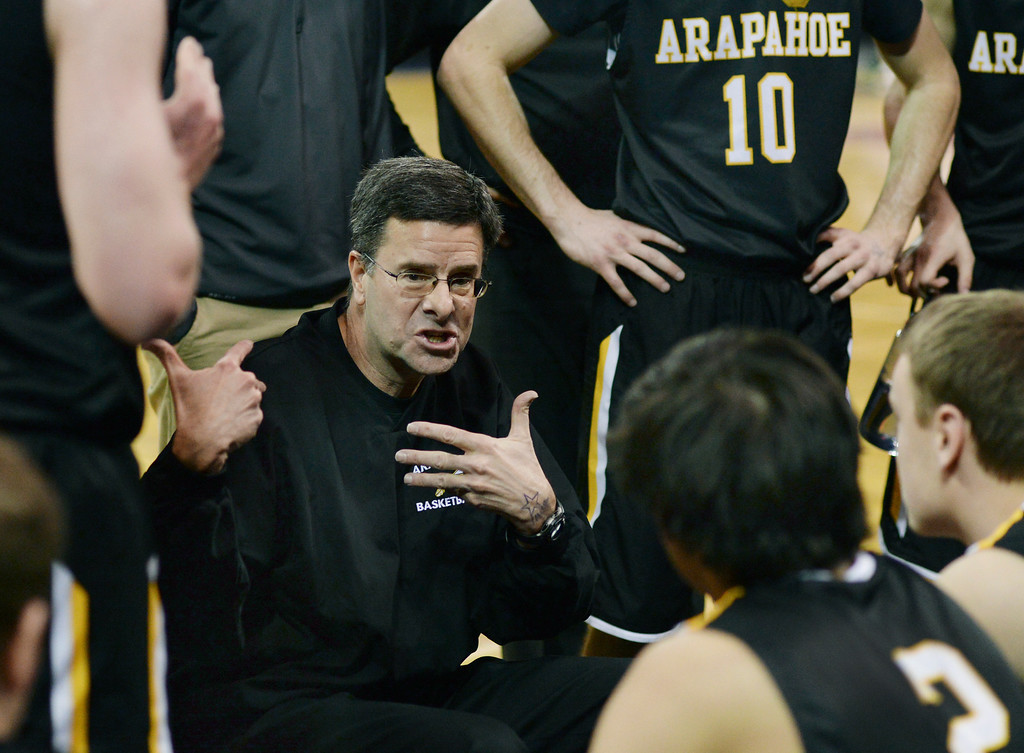 . DENVER, CO - MARCH 7: Arapahoe coach Dan Snyder talked it over with the team during a time out in the first half. The Fossil Ridge High School boy\'s basketball team faced Arapahoe Friday night, March 7, 2014 in Denver, Colorado. (Photo by Karl Gehring/The Denver Post)