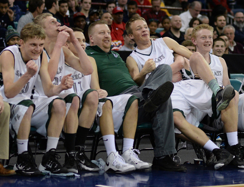. DENVER, CO - MARCH 7: Fossil Ridge coach Matt Johannsen enjoyed the last minute of the game with his starters on the bench. The Fossil Ridge High School boy\'s basketball team defeated Arapahoe 68-58 in a 5A quarterfinal playoff game Friday night, March 7, 2014 in Denver, Colorado. (Photo by Karl Gehring/The Denver Post)