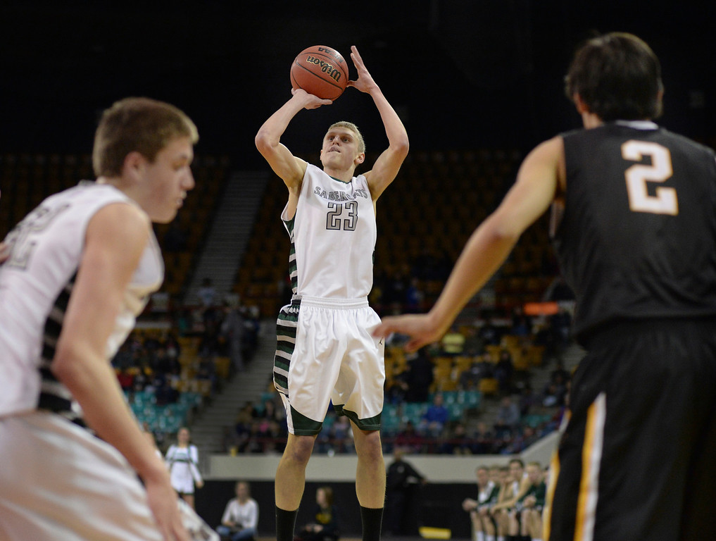 . DENVER, CO - MARCH 7: SaberCats forward Alex Semadeni (23) had an open shot from outside in the first half. The Fossil Ridge High School boy\'s basketball team faced Arapahoe Friday night, March 7, 2014 in Denver, Colorado. (Photo by Karl Gehring/The Denver Post)