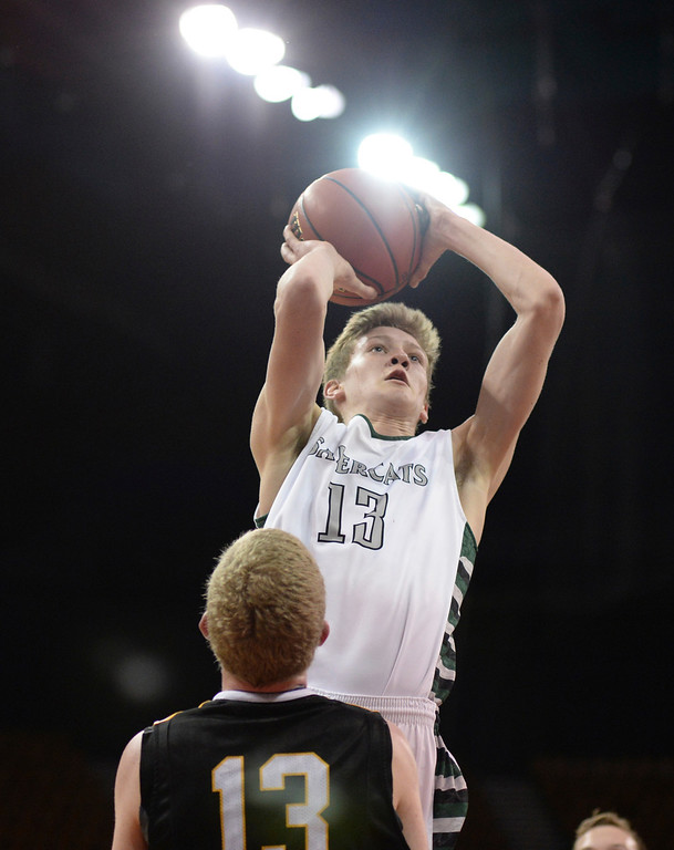 . DENVER, CO - MARCH 7: Fossil Ridge senior point guard Sawyer Novak (13) shot over Arapahoe\'s Brendan Till in the first half. The Fossil Ridge High School boy\'s basketball team faced Arapahoe Friday night, March 7, 2014 in Denver, Colorado. (Photo by Karl Gehring/The Denver Post)
