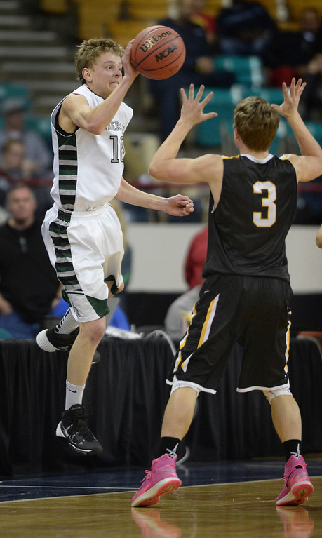 . DENVER, CO - MARCH 7: Fossil Ridge junior wing Andy Semadeni (10) saved the ball from going out of bounds in the first half. The Fossil Ridge High School boy\'s basketball team faced Arapahoe Friday night, March 7, 2014 in Denver, Colorado. (Photo by Karl Gehring/The Denver Post)