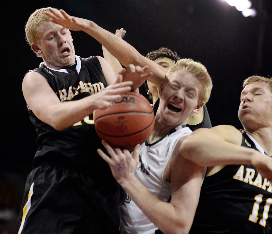 . DENVER, CO - MARCH 7: Arapahoe senior guard Brendan Till (13) fought for a rebound with Fossil Ridge post Matt Laine (33) in the first half. The Fossil Ridge High School boy\'s basketball team faced Arapahoe Friday night, March 7, 2014 in Denver, Colorado. (Photo by Karl Gehring/The Denver Post)