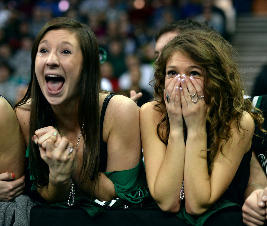 . DENVER, CO - MARCH 7: Fossil Ridge students Riley Speir, left, and Ava Norrigan, right, reacted to the action in the first half. The Fossil Ridge High School boy\'s basketball team faced Arapahoe Friday night, March 7, 2014 in Denver, Colorado. (Photo by Karl Gehring/The Denver Post)