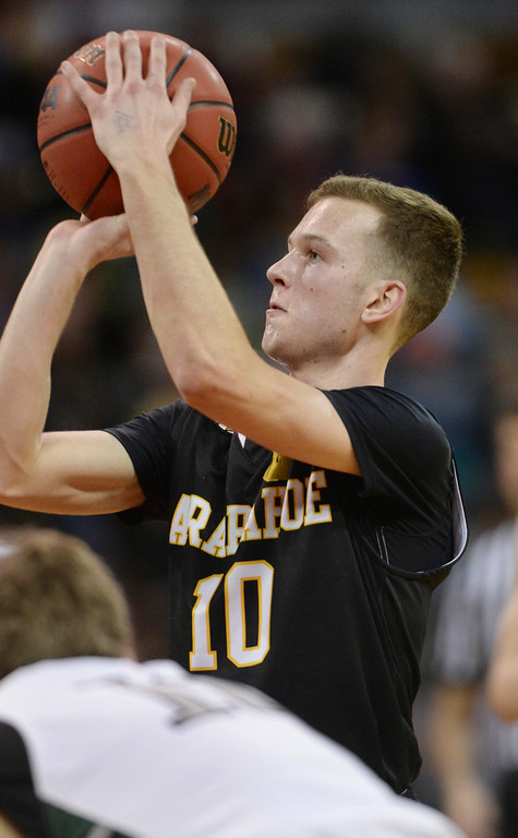 . DENVER, CO - MARCH 7: Arapahoe senior Corbin Atwell went to the line in the first half. The Fossil Ridge High School boy\'s basketball team faced Arapahoe Friday night, March 7, 2014 in Denver, Colorado. (Photo by Karl Gehring/The Denver Post)