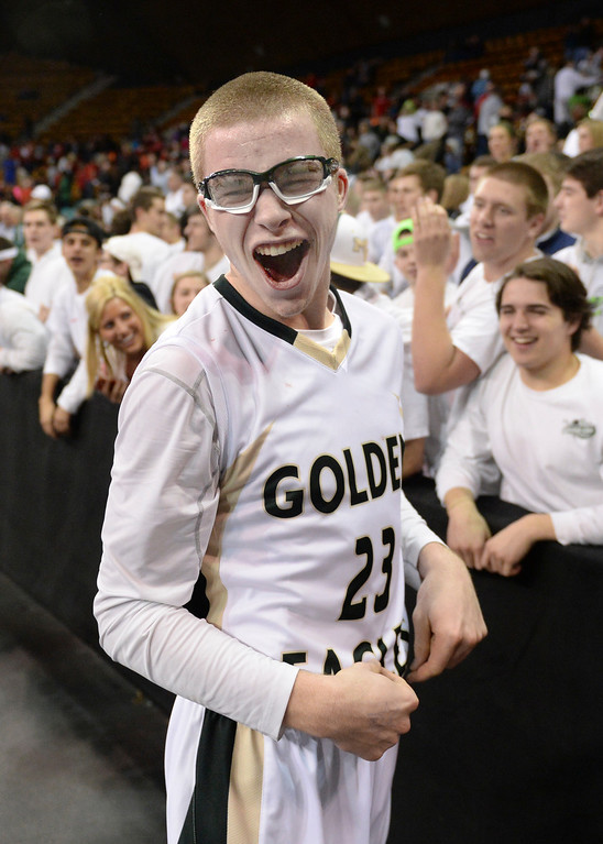 . DENVER, CO - MARCH 7: Mountain Vista guard Brady Subar celebrated with the student section. The Mountain Vista High School boy\'s basketball team beat Eaglecrest 65-61 in a 5A quarterfinal playoff game Friday night, March 7, 2014 in Denver, Colorado. (Photo by Karl Gehring/The Denver Post)