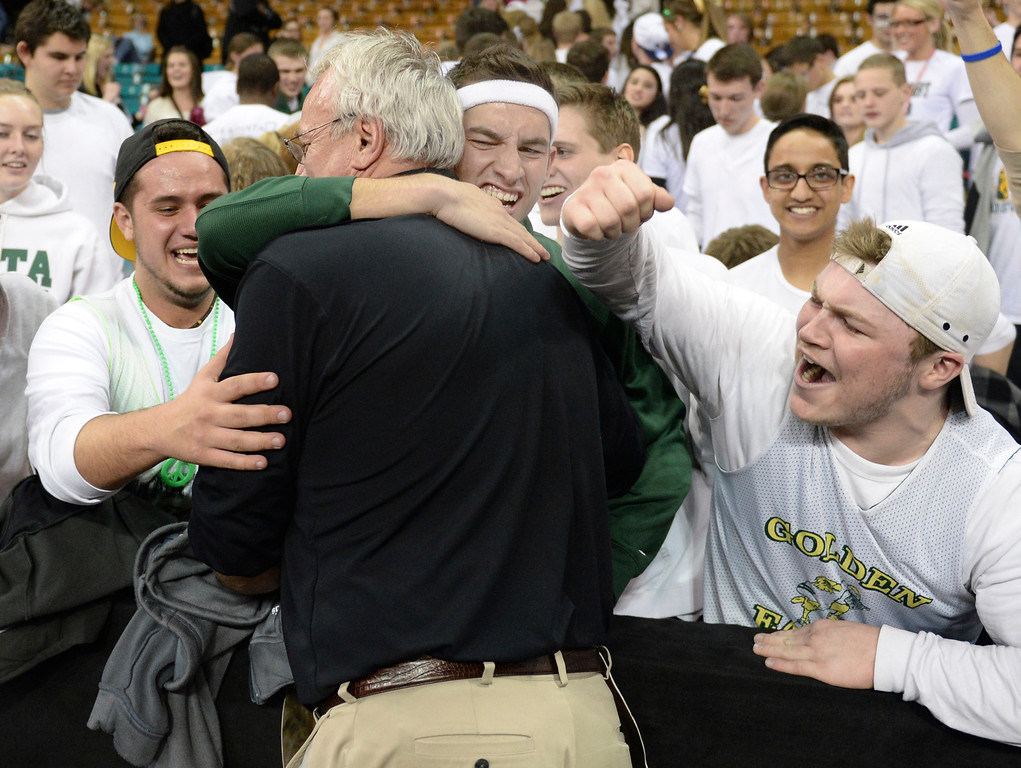 . DENVER, CO - MARCH 7: Mountain Vista coach Bob Wood enjoyed the win with students. The Mountain Vista High School boy\'s basketball team beat Eaglecrest 65-61 in a 5A quarterfinal playoff game Friday night, March 7, 2014 in Denver, Colorado. (Photo by Karl Gehring/The Denver Post)