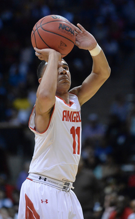 . BOULDER, CO - MARCH 14: Angels\' guard Brian Carey put up a shot in the first half. The Denver East High School boy\'s basketball team matched up against Overland in a 5A semifinal game Friday night, March 14, 2014 in Boulder, Colorado. (Photo by Karl Gehring/The Denver Post)