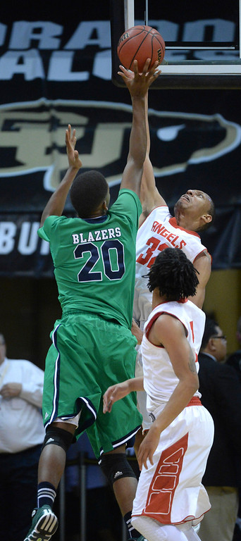 . BOULDER, CO - MARCH 14: Angels forward Tyre Robinson (32) went up to block an attempt from Overland center De\'Ron Davis (20) in the first half. The Denver East High School boy\'s basketball team matched up against Overland in a 5A semifinal game Friday night, March 14, 2014 in Boulder, Colorado. (Photo by Karl Gehring/The Denver Post)