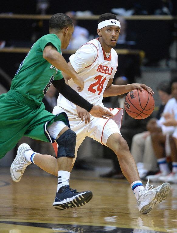 . BOULDER, CO - MARCH 14: East guard Dom Collier (24) brought the ball back on offense in the first half. The Denver East High School boy\'s basketball team advanced to the championship game after a 77-65 win over Overland in a 5A semifinal game Friday night, March 14, 2014 in Boulder, Colorado. (Photo by Karl Gehring/The Denver Post)