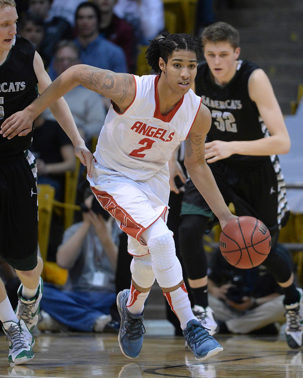 . BOULDER, CO - MARCH15: East guard Jevon Griffin (2) brought the ball back on offense. The Denver East High School boy\'s basketball team took the 5A championship game with a 70-49 win over Fossil Ridge Saturday night, March 15, 2014 in Boulder, Colorado. (Photo by Karl Gehring/The Denver Post)