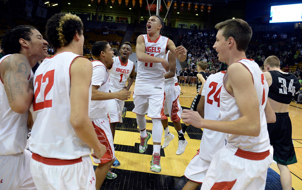 . BOULDER, CO - MARCH15: Brian Carey celebrated at mid court with teammates after the win. The Denver East High School boy\'s basketball team took the 5A championship game with a 70-49 win over Fossil Ridge Saturday night, March 15, 2014 in Boulder, Colorado. (Photo by Karl Gehring/The Denver Post)