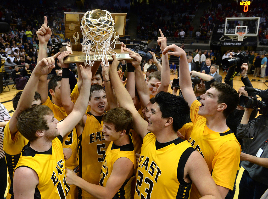 . BOULDER, CO - MARCH15: The Eagles paraded the championship trophy around the court. The Pueblo East High School boy\'s basketball team took the 4A state title with a 58-51 win over Denver South in the championship game Saturday night, March 15, 2014 in Boulder, Colorado. (Photo by Karl Gehring/The Denver Post)