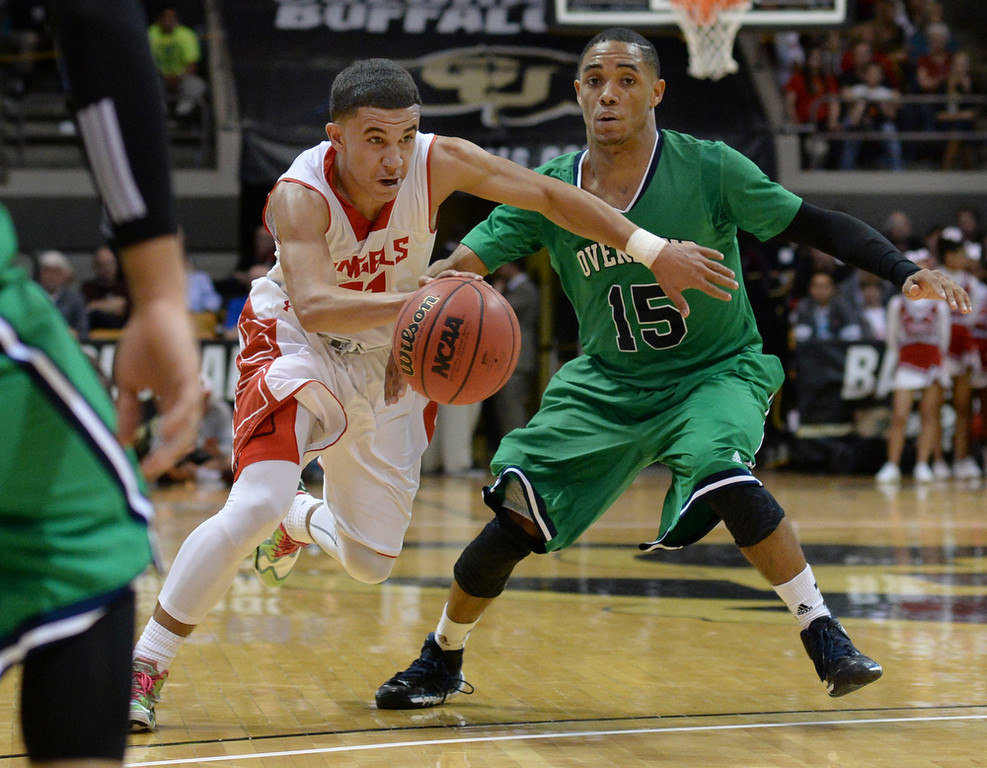. Angels\' guard Brian Carey (11) worked against Overland defender Austin Conway (15) in the first half. The Denver East High School boy\'s basketball team advanced to the championship game after a 77-65 win over Overland in a 5A semifinal game Friday night, March 14, 2014 in Boulder, Colorado. (Photo by Karl Gehring/The Denver Post)