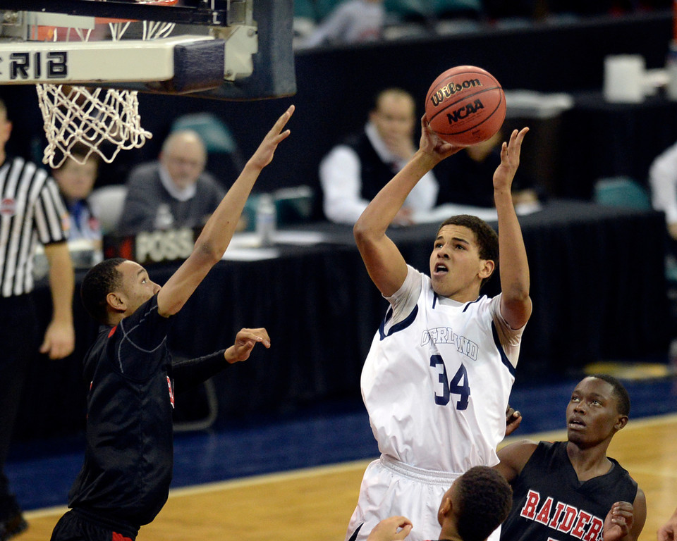 . Overland forward Ryan Swan (34) put up a shot in the second half. Swan finished with 18 points. The Overland High School boy\'s basketball team defeated Rangeview 64-47 Friday night, March 7, 2014 in Denver, Colorado. (Photo by Karl Gehring/The Denver Post)
