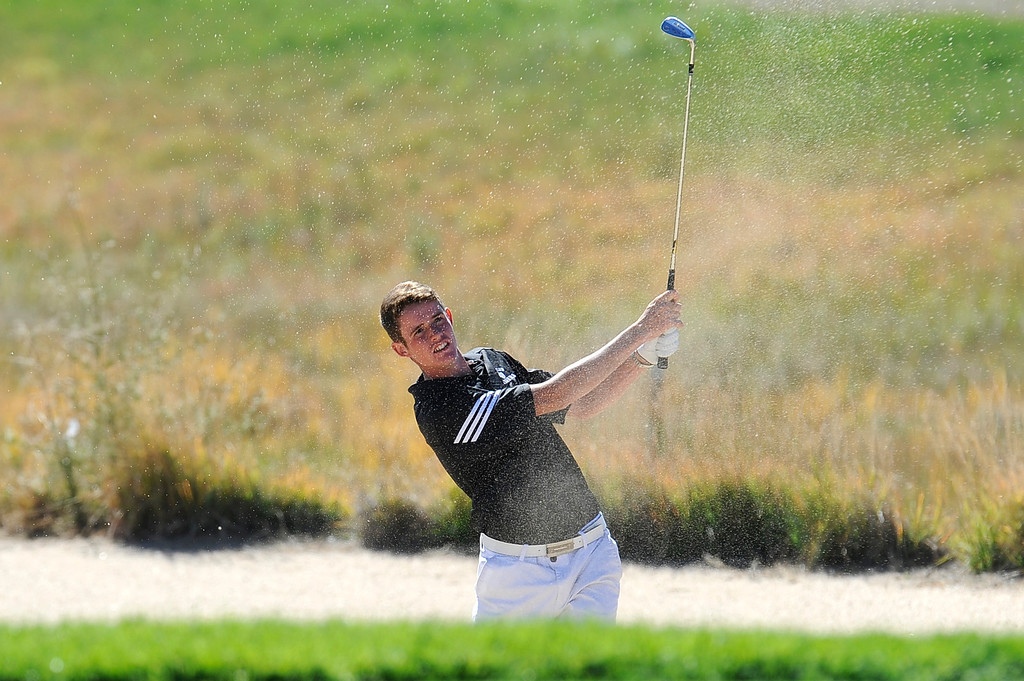 . AURORA, CO: Oct. 1, 2013  Donny Kinnaman hits a shot out of a sand trap during final round of the 5A state golf tournament at Murphy Creek Golf Course.   (Photo By Erin Hull/The Denver Post)