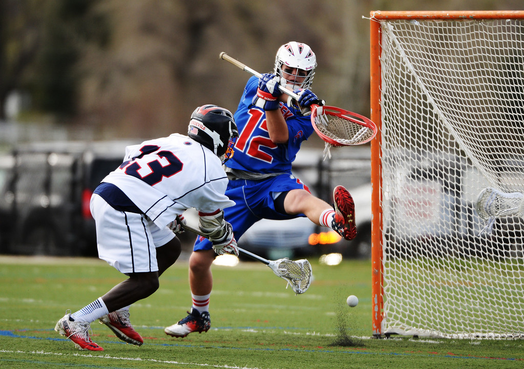 . ENGLEWOOD MAY 02: Goalie Addison Christensen of  Cherry Creek High School (12) saves the goal from Jaden Franklin of Kent Denver High School (13). Englewood, Colorado May 2, 2014. (Photo by Hyoung Chang/The Denver Post)