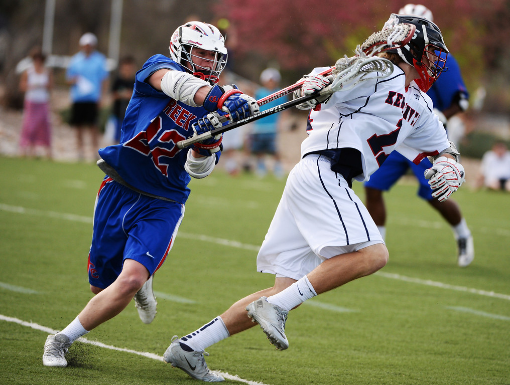 . ENGLEWOOD MAY 02: Michael Morean of Cherry Creek High School (22), left, checks Ryan Weiss of Kent Denver High School (11) during the game. Englewood, Colorado May 2, 2014. (Photo by Hyoung Chang/The Denver Post)
