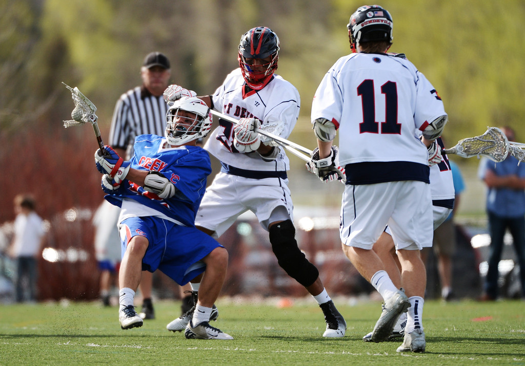 . ENGLEWOOD MAY 02: Henry Adams of Cherry Creek High School (42), left, controls the ball against defenders of Kent Denver High School. Englewood, Colorado May 2, 2014. (Photo by Hyoung Chang/The Denver Post)