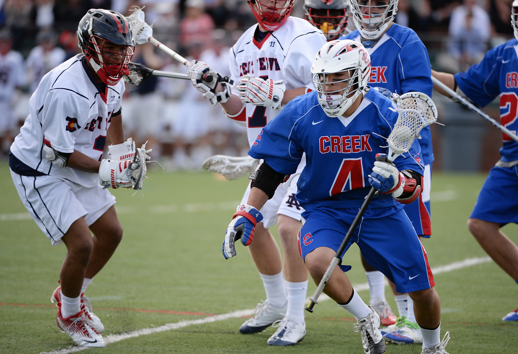 . ENGLEWOOD MAY 02: Tristan Snellgrove of Cherry Creek High School (4) controls the ball against Kent Denver High School defense. Englewood, Colorado May 2, 2014. (Photo by Hyoung Chang/The Denver Post)
