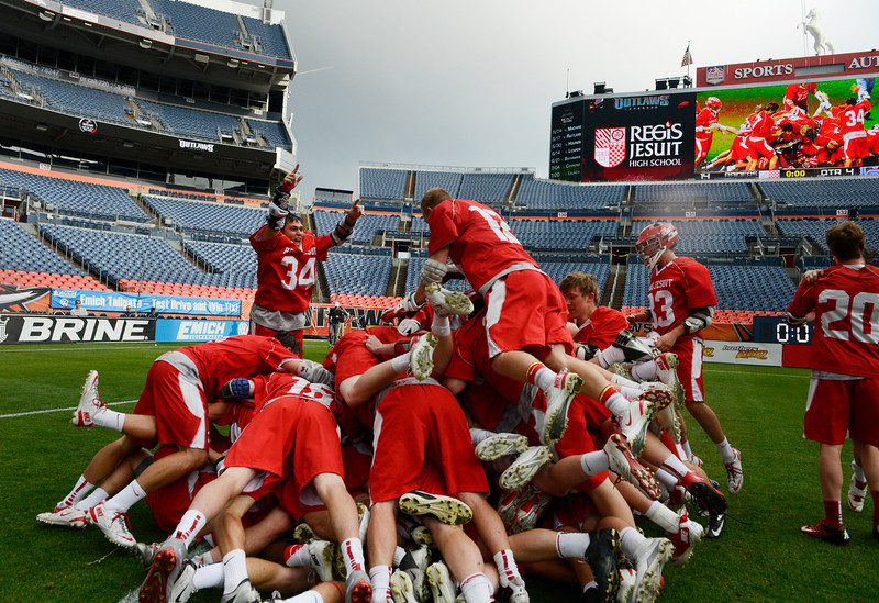 . Regis Lacrosse team celebrates their Colorado State 5A boys lacrosse championship at Sports Authority Field at Mile High Saturday evening, May 17, 2014. Regis defeated Cherry Creek, 14-7.  (Photo By Andy Cross / The Denver Post)