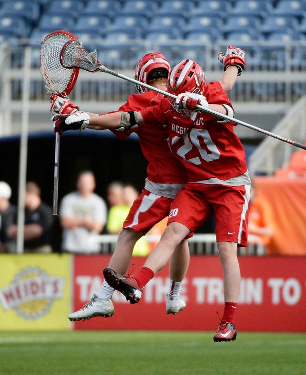 . Regis defenseman Adam Kratt  right celebrates with goalie Brett Quartuccio, Colorado State 5A boys lacrosse championship at Sports Authority Field at Mile High Saturday evening, May 17, 2014. (Photo By Andy Cross / The Denver Post)
