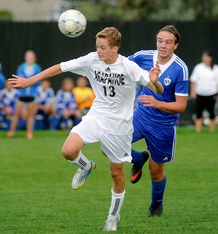. Grandview striker Alex Simpson (8) pressured Arapahoe defender Mitchel Fisher (13) in the second half. The Grandview High School boy\'s soccer team defeated Arapahoe 2-0 Thursday evening, September 19, 2013.  Photo By Karl Gehring/The Denver Post