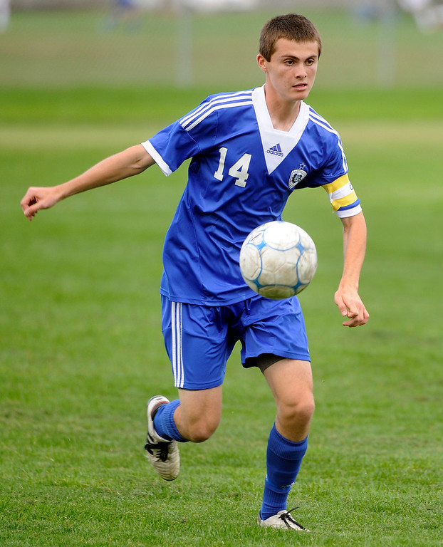 . Grandview defender Alex Bender (14) cleared the ball in the first half. The Grandview High School boy\'s soccer team defeated Arapahoe 2-0 Thursday evening, September 19, 2013.  Photo By Karl Gehring/The Denver Post
