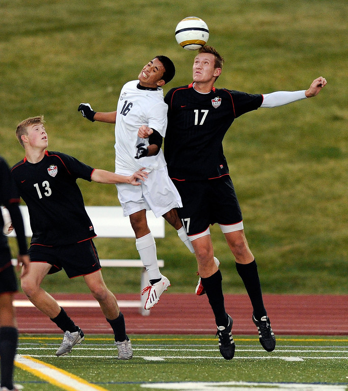 . East defender Sam Reum (17) went for a header against Rangeview forward Jack Ramirez (16) in the second half.  Photo By Karl Gehring/The Denver Post