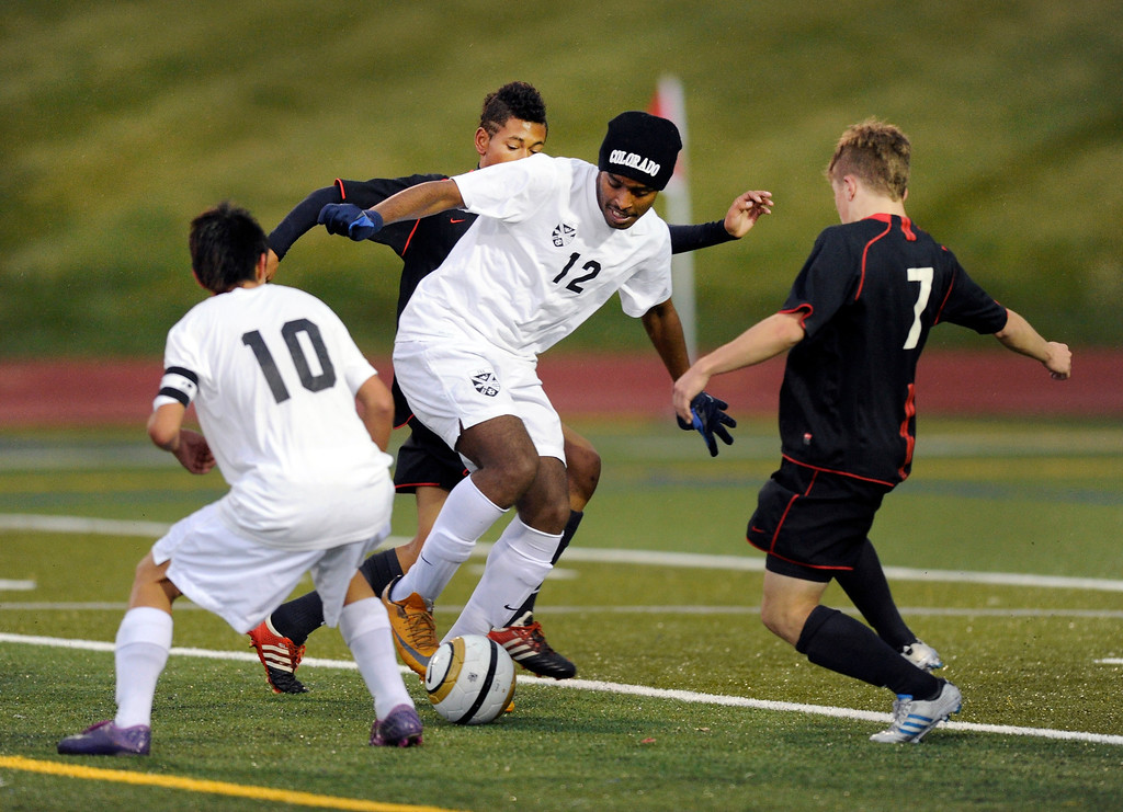 . Rangeview midfielder Marcos Wolde (12) worked through traffic in the second half.   Photo By Karl Gehring/The Denver Post