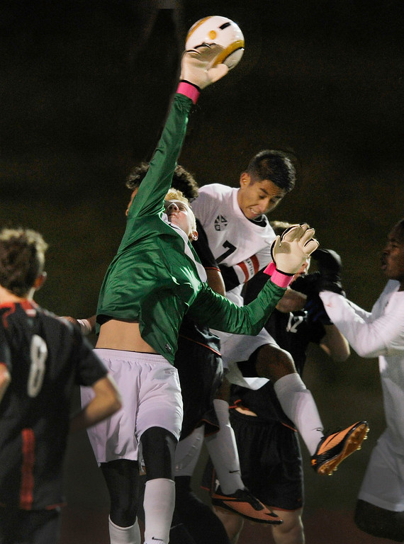 . East goalkeeper Will Palmquist punched the ball away on a Rangeview corner kick in the second half.  Photo By Karl Gehring/The Denver Post