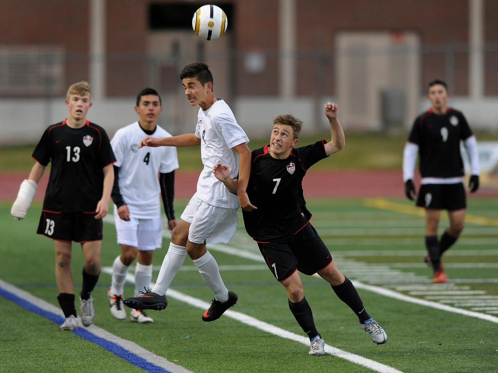. Rangeview midfielder Troy Hudson (8) headed the ball over East senior Ian Loefgren (7) in the first half.   Photo By Karl Gehring/The Denver Post
