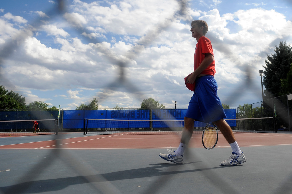 . Zach Fryer of Cherry Creek walks across the court during his No. 1 seeded singles match against Fairview\'s Ignatius Castelino.   (Photo By Erin Hull/The Denver Post)