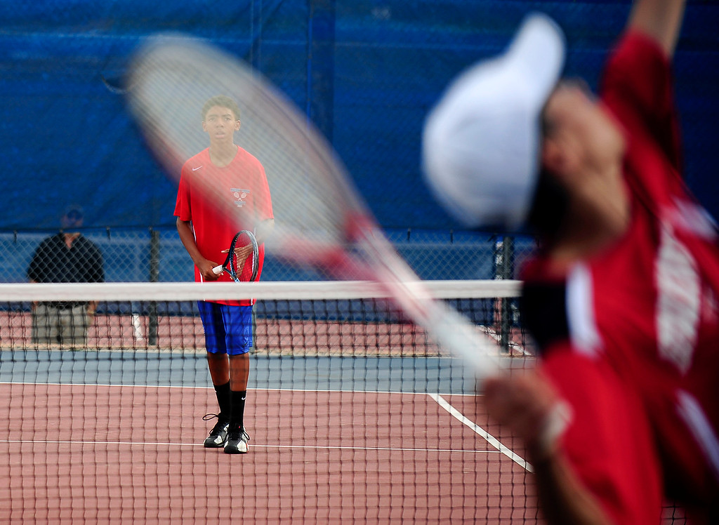 . Cherry Creek\'s Erin Norwood looks on as Fairview\'s Randall Ball serves to him during their doubles match on Tuesday, September 3, 2013. (Photo By Erin Hull/The Denver Post)