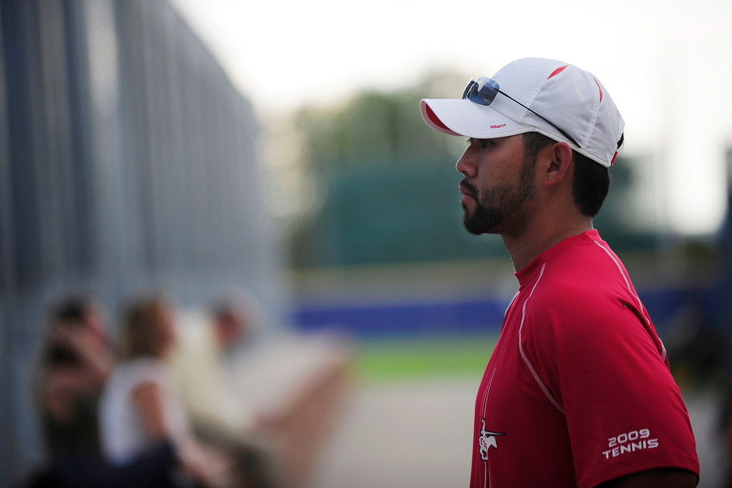 . Fairview tennis coach Chad Tsuda watches his players during the meet.   (Photo By Erin Hull/The Denver Post)