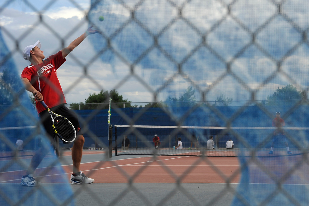 . Fairview\'s May Petrak serves during his doubles match. (Photo By Erin Hull/The Denver Post)