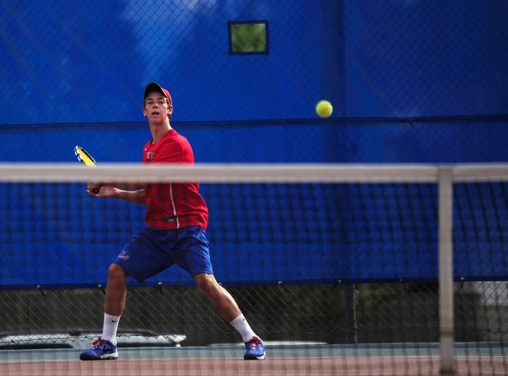 . In the No. 2 singles match,  Connor McPherson of Cherry Creek rallies against Fairview\'s Alec Leddon.  (Photo By Erin Hull/The Denver Post)