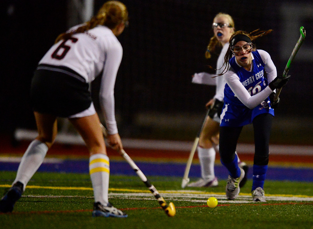 . Colorado Academy\'s Julia Murphy defends as Cherry Creek\'s Ashley Hilyard hits during the CHSAA state field hockey championship. Colorado Academy (17-0) capped a perfect season at All-City Stadium. (Photo by AAron Ontiveroz/The Denver Post)